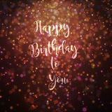 Happy birthday to you card golden and purple. Happy birthday to you card golden bokeh effect particles lighting from top Stock Photo