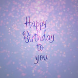Happy birthday to you card. Purple and gold bokeh background lighting from top populated on top rare at bottom with text happy birtday to you Stock Photo