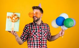 happy birthday to you. male holiday celebration. bearded guy with party balloons and gift box. unshaven handsome man