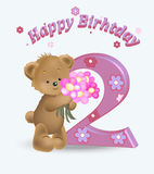 Happy birthday two years. The little teddy bear with a bouquet of flowers, congratulates on the second anniversary Royalty Free Stock Image