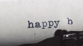 Happy birthday - Typed on an old vintage typewriter. Close-up stock video footage