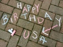 Happy 4th of July, Happy Birthday USA. Happy Birthday USA written in red, white, and blue chalk. This photo was taken in Rutherford, New Jersey, USA, on July 4th stock photography