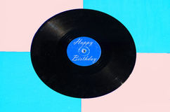 Happy Birthday vinyl and colored background Royalty Free Stock Photography