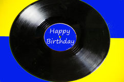Happy Birthday vinyl and colored background Royalty Free Stock Photos