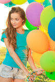 Happy birthday woman against the sky with rainbow-colored air ba royalty free stock image