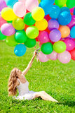 Happy birthday woman against the sky with rainbow-colored air ba Stock Photo