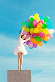 Happy birthday woman against the sky with rainbow-colored air ba Royalty Free Stock Photography