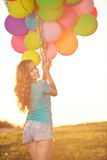 Happy birthday woman against the sky with rainbow-colored air ba Stock Images