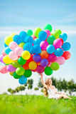 Happy birthday woman against the sky with rainbow-colored air ba Royalty Free Stock Images