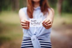 Happy birthday - woman hold greeting card with text, anniversary and celebration concept. Happy birthday - woman hold greeting card with words, beautiful royalty free stock image