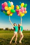 Happy birthday women against the sky with rainbow-colored air ba Stock Photos