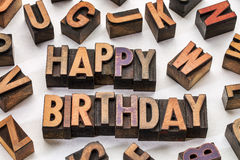 Happy birthday in wood type blocks Stock Photos