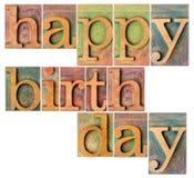 Happy birthday in wood type Stock Photos