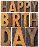 Happy birthday in wood type Royalty Free Stock Image