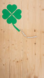 Happy Birthday on wood. The words Happy Birthday and a cloverleaf on a cord on wood Stock Image