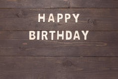 Happy Birthday on wooden background with copy space Stock Images