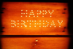 Happy birthday on a wooden board Royalty Free Stock Image