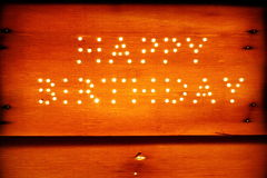 Happy birthday on a wooden board Stock Images