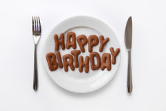 Happy Birthday written with biscuits Stock Image