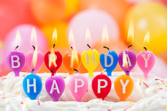 Happy Birthday written in lit candles royalty free stock photo