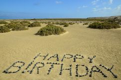 Happy Birthday Written With Stones On The Sand Royalty Free