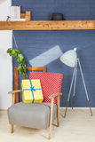 Happy Birthday!. Yellow wrapped gift on polkadot chair in modern house Royalty Free Stock Photo