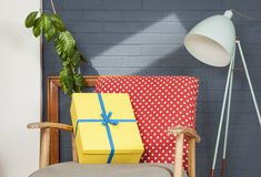 Happy Birthday!. Yellow wrapped gift on polkadot chair in modern house Royalty Free Stock Photography