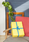 Happy Birthday!. Yellow wrapped gift on polkadot chair in modern house Royalty Free Stock Images