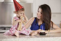 Happy birthday!. Young mother celebrating her baby girls birthday Royalty Free Stock Images