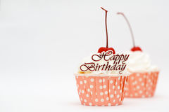 Happy birtthday word and cup cake with red cherry Royalty Free Stock Photos