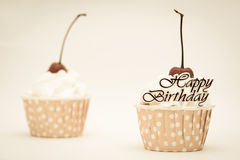 Happy birtthday word and cup cake with red cherry Stock Photos