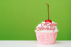 Happy birtthday word and cup cake with red cherry Royalty Free Stock Photography