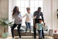 Happy black African family dancing at home royalty free stock photos