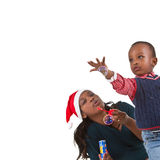 Happy black baby boy with mom. Young baby boy getting ready for christmas with his mother Stock Photo
