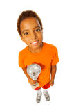 Happy black boy with prize cup Royalty Free Stock Photo