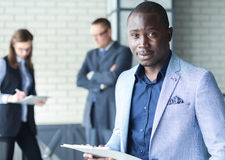 Happy black business man stock images