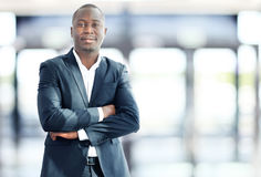 Happy black business man. Work in modern office stock photography