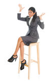 Happy black businesswoman seated on chair. stock images
