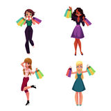 Happy black and Caucasian women with shopping bags, holiday sale Royalty Free Stock Photos