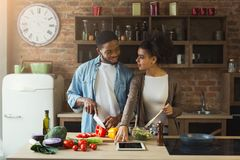 Happy black couple cooking healthy food together Stock Image