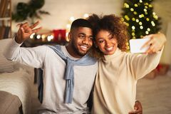 Free Happy Black Couple Making Selfie On Christmas Eve Royalty Free Stock Images - 160628369
