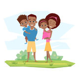 Happy black family smiling in nature. Parents hold children Stock Images