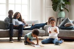 Happy black family spending free time together royalty free stock image