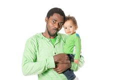 Happy black father and child boy cuddling on isolated white background. Royalty Free Stock Photography
