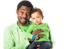 Happy black father and child boy cuddling on isolated white background. Stock Photos