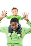 Happy black father and child boy cuddling on isolated white background. Royalty Free Stock Photo