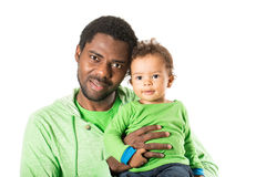 Happy black father and child boy cuddling on isolated white background. Stock Photo