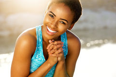 Happy black fitness woman laughing outside. Portrait of happy black fitness woman laughing outside Stock Images