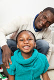 Happy black girl in christmas with her dad. Pretty black girl smiling at camera Royalty Free Stock Photos