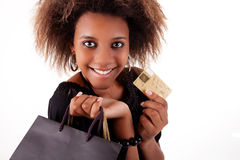 Happy black girl with shopping bags, credit card
